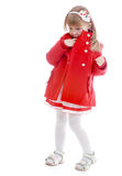 Adorable little fashion girl in a short striped Royalty Free Stock Image