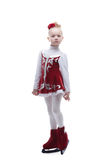 Adorable little figure skater posing in studio Royalty Free Stock Photos
