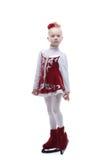 Adorable little figure skater posing in studio Royalty Free Stock Photos