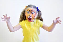 Adorable little gir painted like tiger by artist Royalty Free Stock Photos