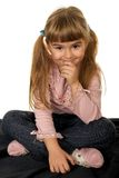 Adorable little girl. Thinking and smiling stock photos
