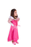 Adorable little girl. Cute little girl dress in a pink princess costume standing with her hands on her hips. Isolated on white Stock Photo