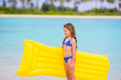 Adorable little girl with air inflatable mattress during beach vacation Stock Photography