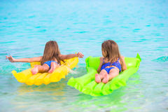 Adorable little girl on air inflatable mattress in Stock Photography