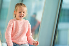 Adorable little girl in airport have fun waiting Royalty Free Stock Photo