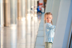 Adorable little girl in airport near big window waiting for boarding Royalty Free Stock Images