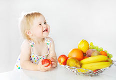 Adorable little girl with apple Royalty Free Stock Photos