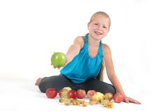 Adorable little girl with apple Stock Photo