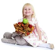 Adorable little girl with an apple Stock Image