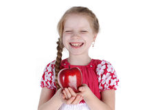 Adorable little girl with apple Stock Photography