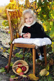 Adorable little girl with apples, autumn time Royalty Free Stock Photo