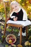 Adorable little girl with apples, autumn time Royalty Free Stock Images