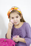 Adorable little girl applying make-up with powder Royalty Free Stock Photo