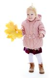 Adorable little girl in autumn coat holding a Royalty Free Stock Photography