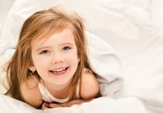 Adorable little girl awaked up Stock Images
