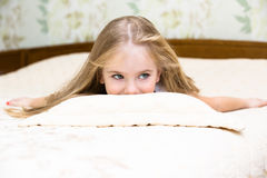 Adorable little girl awaked up in bed. Adorable little girl awaked up in her bed Stock Photo