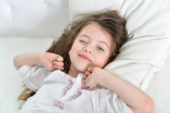 Adorable little girl awaked up Stock Photography