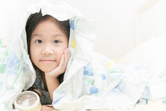 Adorable little girl awaked up in her bed Stock Images