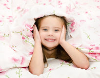 Adorable little girl awaked up in her bed Royalty Free Stock Photo