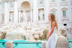 Adorable little girl background Trevi Fountain, Rome, Italy. Happy toodler kid enjoy italian vacation holiday in Europe Royalty Free Stock Image