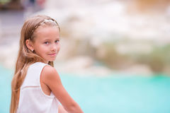 Adorable little girl background Trevi Fountain, Rome, Italy. Happy toodler kid enjoy italian vacation holiday in Europe. Royalty Free Stock Photos