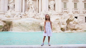 Adorable little girl background Trevi Fountain, Rome, Italy. Happy toodler kid enjoy italian vacation holiday in Europe. stock video footage