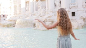 Adorable little girl background Trevi Fountain, Rome, Italy. Happy toodler kid enjoy italian vacation holiday in Europe. stock footage