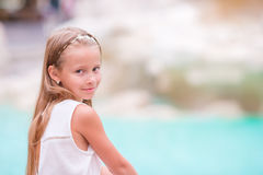 Adorable little girl background Trevi Fountain, Rome, Italy. Happy toodler kid enjoy italian vacation holiday in Europe. Young beautiful girl near fountain Royalty Free Stock Photo