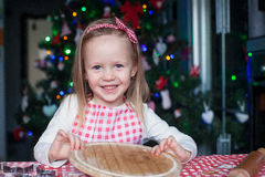 Adorable little girl baking gingerbread Christmas Royalty Free Stock Images