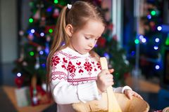 Adorable little girl baking gingerbread cookies Royalty Free Stock Photo