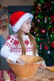 Adorable little girl baking gingerbread cookies Royalty Free Stock Photography