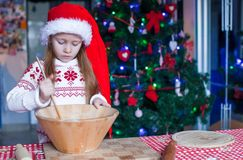 Adorable little girl baking gingerbread cookies Stock Photo