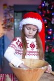 Adorable little girl baking gingerbread cookies Stock Photography