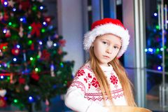 Adorable little girl baking gingerbread cookies Stock Photos