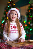 Adorable little girl baking gingerbread cookies Royalty Free Stock Images