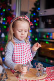 Adorable little girl baking gingerbread cookies Stock Image