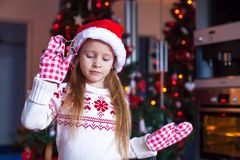 Adorable little girl baking gingerbread cookies Royalty Free Stock Photos