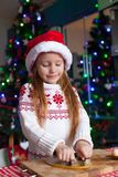 Adorable little girl baking gingerbread cookies Stock Images