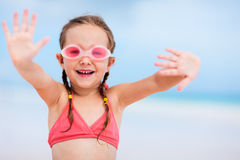 Adorable little girl at beach. On summer vacation Stock Images