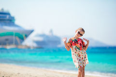 Adorable little girl at beach background big cruise lainer in Greece Stock Images