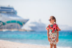 Adorable little girl at beach background big lainer in Greece Royalty Free Stock Image
