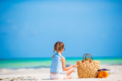 Adorable little girl with beach bag and towel during summer vacation Royalty Free Stock Photos
