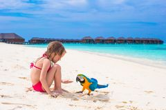 Adorable little girl at beach with big colorful Royalty Free Stock Images