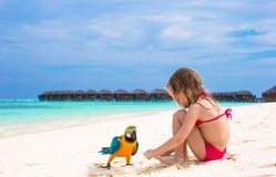 Adorable little girl at beach with big colorful Stock Images