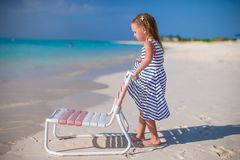 Adorable little girl on beach chair during Stock Photo