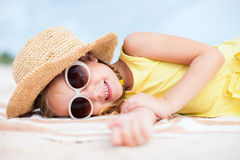 Adorable little girl at the beach Stock Images