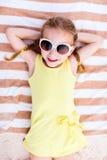 Adorable little girl at the beach Royalty Free Stock Photos