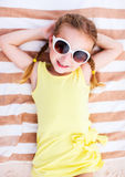 Adorable little girl at the beach Royalty Free Stock Images