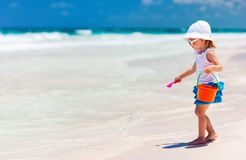 Adorable little girl at beach. Adorable little girl playing with toys at tropical beach stock photo