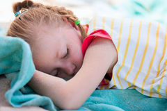 Adorable little girl at beach sleeping Royalty Free Stock Photo